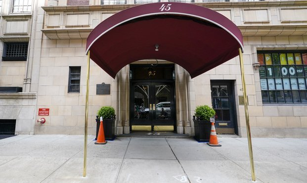 The entrance to the apartment building where former New York Mayor Rudy Giuliani resides. Photo: Mary Altaffer/AP