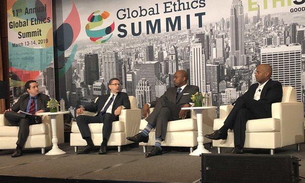 (left to right) Reagan Demas, a partner at Baker McKenzie; Mike Kolloway, a senior vice president and general counsel at Parsons Corp.; Antonio Robinson, an associate general counsel at Carters; Damien Atkins, a general counsel and secretary at The Hershey Co., speak about supply chain ethics at the 2019 Global Ethics Summit at The Grand Hyatt New York. Photo: Daniel Clark/ALM