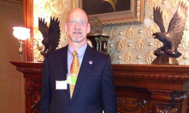 Burl Finkelstein, Kason Industries general counsel, standing inside the Eisenhower Executive Office Building next to the West Wing. Courtesy photo.