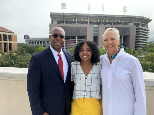 AT&T SVP & CCO, David Huntley, left, his wife, Tracey Nash-Huntley, right, and LSU student, Staci Shelby, center, at the LSU Foundation next to LSU's Tiger Stadium.