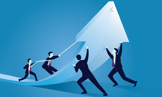Business Team Work Concept. Businessmen working together to change direction of an arrow. Raising up arrow to reach success together