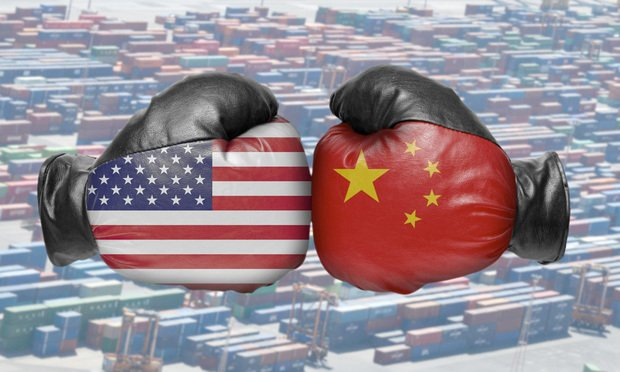 Two boxing gloves showing US China trade war.