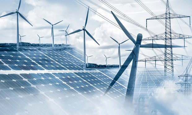 wind turbines, solar panels and electricity pylons