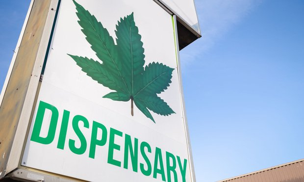 Cannabis dispensary sign. Credit: Adam Melnyk/Shutterstock.com.