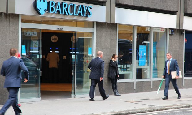 People walk by Barclays bank branch in London. Credit: Tupungato/Shutterstock.com