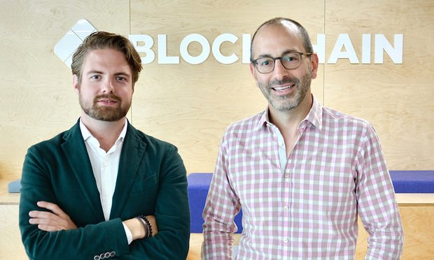 Blockchain co-founder and CEO Peter Smith (left) with Howard Surloff. (Courtesy photo: Blockchain)