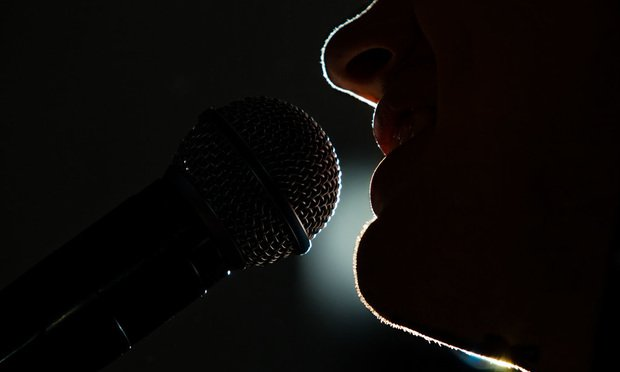 Man at microphone.