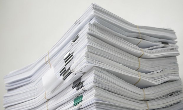 Pile of documents/photo by Fotolia