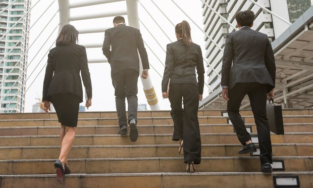 Business professionals walking up the stairs.
