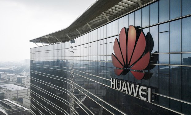 The Huawei Technologies Co. logo is displayed atop an office building at the company's production facility in this aerial photograph taken in Dongguan, China, on Thursday, May 23, 2019. Huawei is seeking about $1 billion from a small group of lenders, its first major funding test after getting hit with U.S. curbs that threaten to cut off access to critical suppliers. Photographer: Qilai Shen/Bloomberg