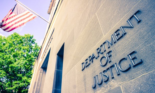 Washinton, DC / USA - April 22 2019: The northern facade of the Department of Justice building in the Nations capital ..