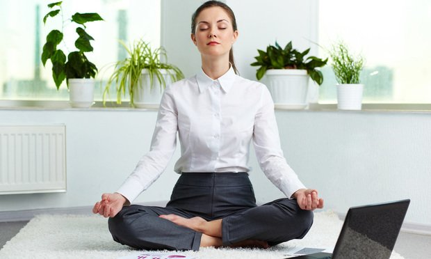 White collar worker meditating in office