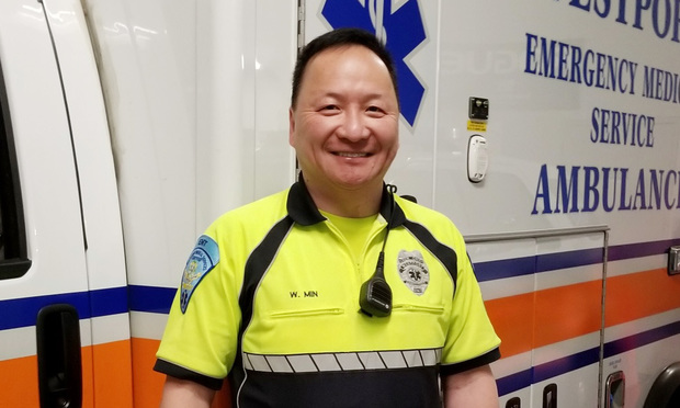 Bill Min, executive vice president and general counsel of the risk and business analytics division of RELX, volunteering as EMT crew chief in Westport, Connecticut. (Photo: Jennifer Richman/LexisNexis Risk Solutions)