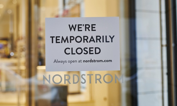 """A """"Temporarily Closed"""" sign hangs in the window of Nordstrom Inc. store in the Midtown neighborhood of New York, U.S., on Friday, March 20, 2020. Some retail segments, such as grocery chains and Walmart, may benefit from the coronavirus outbreak. But for a sector already battered by the shift to online retailing and other structural changes, the coronavirus only portends more pain. Photographer: Gabby Jones/Bloomberg"""