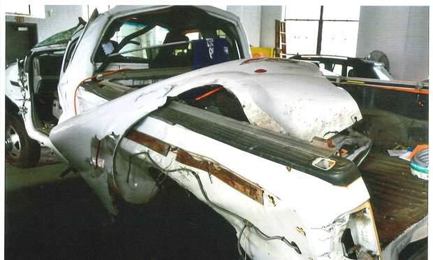 White Ford F-350 pickup truck in police garage after a rear-end collision in November 2016 in which the driver, Kevin Dutra, was killed instantly. Courtesy photo