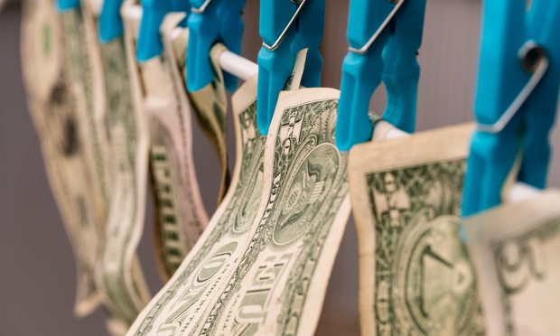 Money Laundering/dollars hung out to dry.
