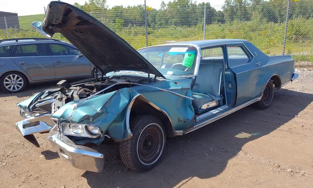 Renee Dubin was driving this 1964 Chrysler New Yorker last year when the brakes failed her and the car crashed into a guard rail and over an embankment, seriously injuring her.
