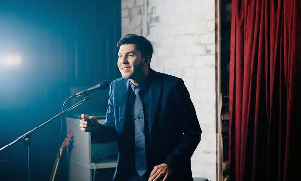 Stand-up comedian on stage.