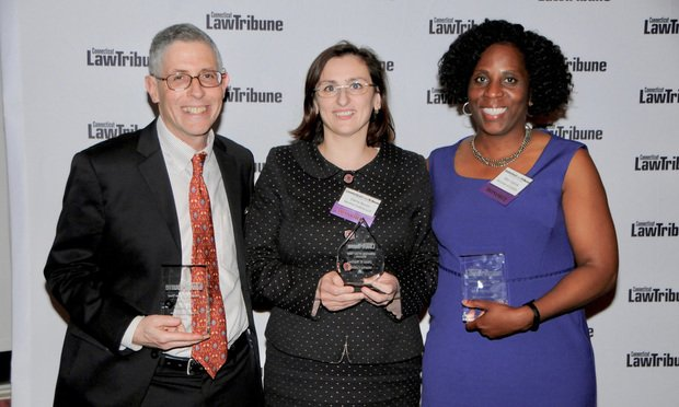 First runner-up Jon Bauer (from left), Attorney of the Year Dana Bucin and second runner-up Moy Ogilvie at the 2019 Connecticut Professional Excellence Awards held May 16 in Hartford. (Photo: Photo: Gary Lewis)