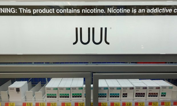 Juul brand e-cigarettes in a case at a retail store.
