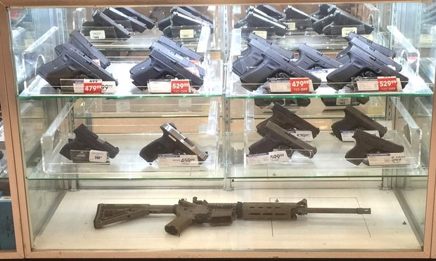 Guns in display for sale, in Monroe, LA.