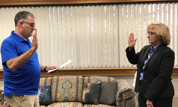Chief State's Attorney Richard Colangelo Jr. (left) swears in Waterbury State's Attorney Maureen Platt for another term on Tuesday.