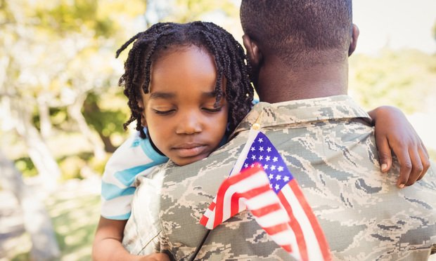 Military man and daughter.