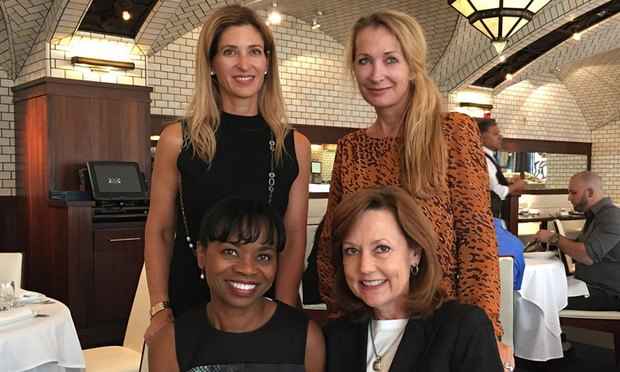 From left, seated, Miami-Dade County Attorney ​Abigail Price-Williams and Broward County Attorney ​Joni Armstrong Coffey. From left, standing, ​Miami-Dade First Assistant County Attorney ​Geri Bonzon Keenan ​and Palm Beach County Attorney ​Denise Nieman. Courtesy photo.
