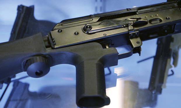 """A device called a """"bump stock"""" is attached to a semi-automatic rifle at the Gun Vault store and shooting range in South Jordan, Utah. Photo: Rick Bowmer/AP"""
