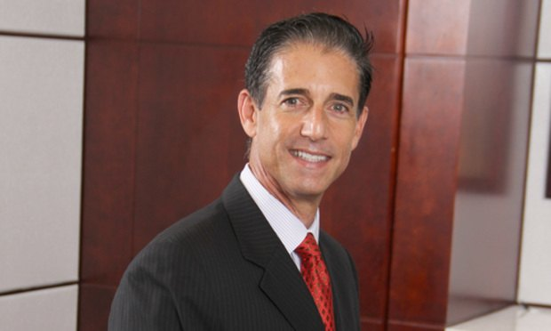 Attorney Edward Guedes represented more than 40 of the local Florida governments and agencies sued over their use of red light cameras. Courtesy photo