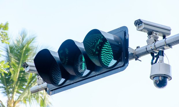 Traffic light and cctv camera. Photo by Aung Myat/Shutterstock.com.