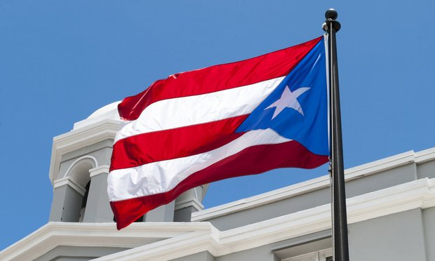 Flag of Puerto Rico in the old town of San Juan. Photo by Ramunas Bruzas/Shutterstock.com