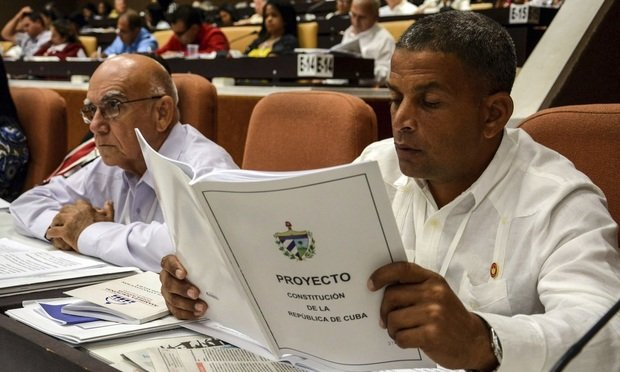 In this July 21, 2018, photo, a member of the National Assembly studies the proposed constitutional update in Havana, Cuba. (Abel Padron, Agencia Cubana de Noticias via AP, File)