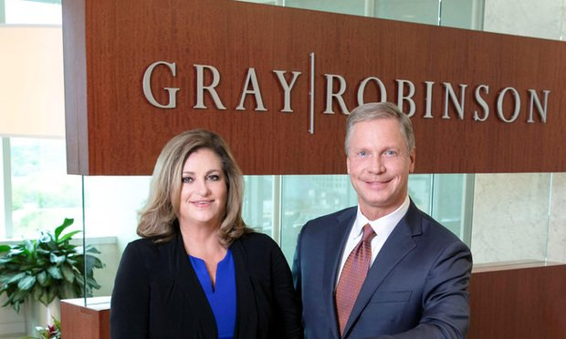 GrayRobinson Partner Mayanne Downs, left, and President and Managing Director Dean Cannon, right.