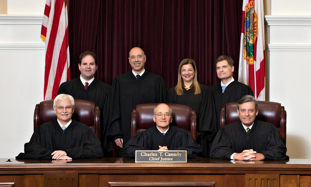 Front row (l-r): Justice Ricky Polston, Chief Justice Charles T. Canady, Justice Jorge Labarga. .Back row (l-r): Justice Robert J. Luck, Justice Alan Lawson, Justice Barbara Lagoa, Justice Carlos G. Muniz. Courtesy photo.