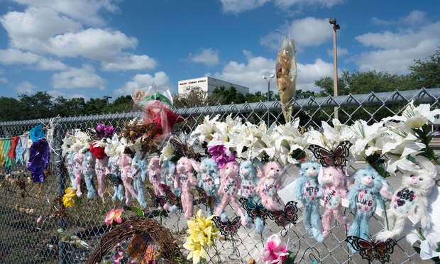 A memorial outside Markory Stoneman Douglas High School after a shooting that killed 17 people. Photo: Janos Rautonen/Shutterstock.com