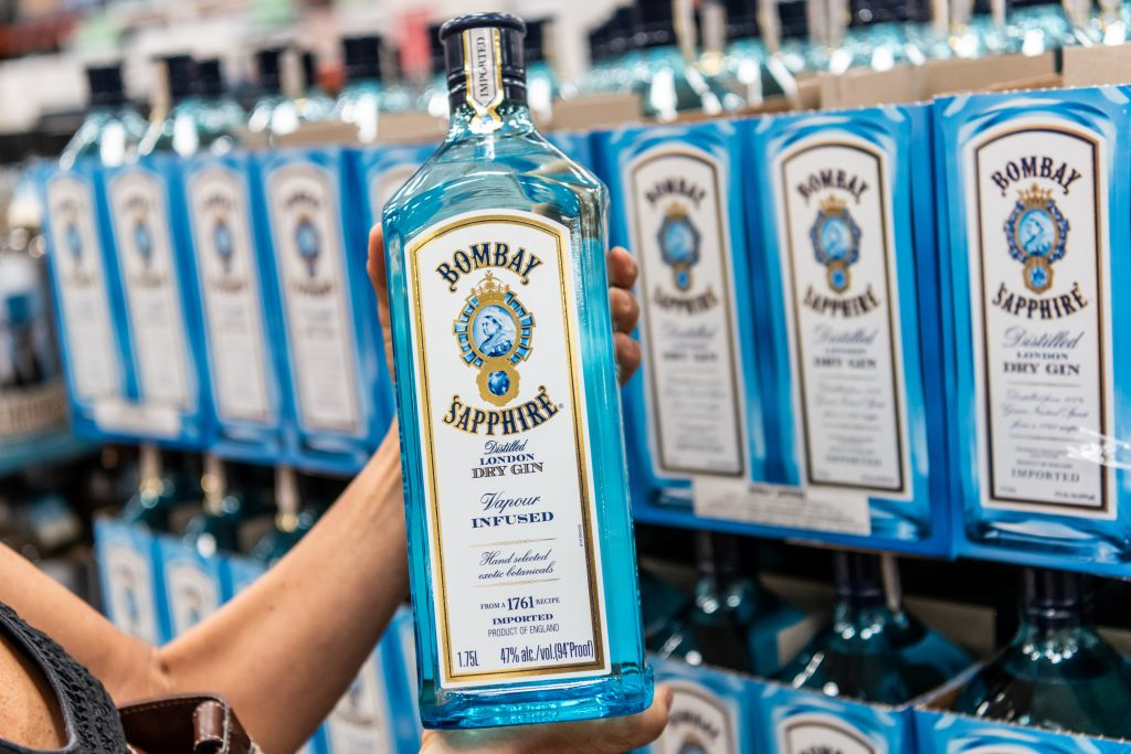 Shopper holding a Bottle of Bombay Sapphire dry gin in a supermarket. Photo: calimedia/Shutterstock.com