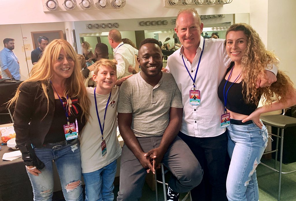 Gray Robinson shareholder Brian Bieber poses for a picture with his family and Hannibal Buress following the comedian's set at Miami's Olympia Theater on August 10, 2019. Courtesy photo
