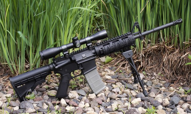 An AR-15 semi-automatic rifle with Burris scope and tripod. Copyright: digitalreflections. Editorial Credit: digitalreflections/Shutterstock.com.