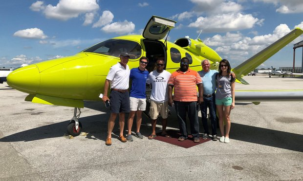 Guy Haggard and Drew Haggard stand with several others at the Fort Lauderdale Executive Airport on Sept. 8, 2019. Guy Haggard flew the plane to The Bahamas with supplies after Hurricane Dorian