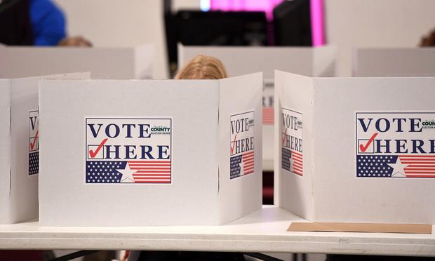 Voting booths/credit: Gino Santa Maria/Shutterstock.com