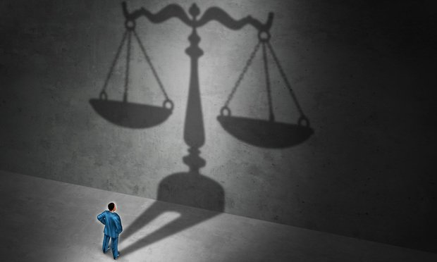 The scales of justice. Photo: Lightspring/Shutterstock.com