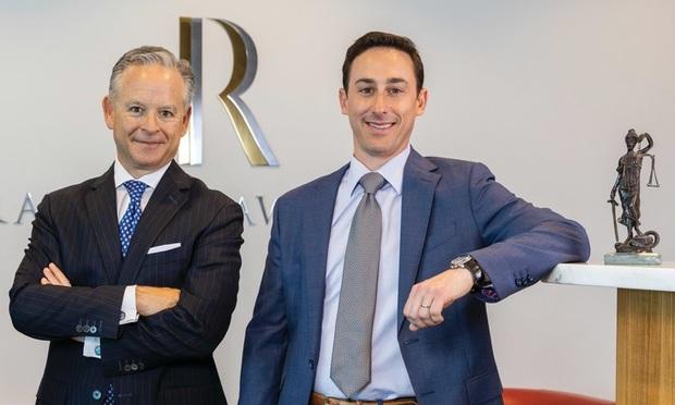 Stuart Ratzan (left) and Stuart Weissman (right) of the Ratzan Law Group in Miami. Courtesy photo.