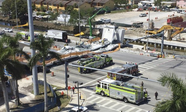 The pedestrian bridge collapsed on Mar. 15, 2018, killing six people and injuring several others. (Roberto Koltun/The Miami Herald via AP)