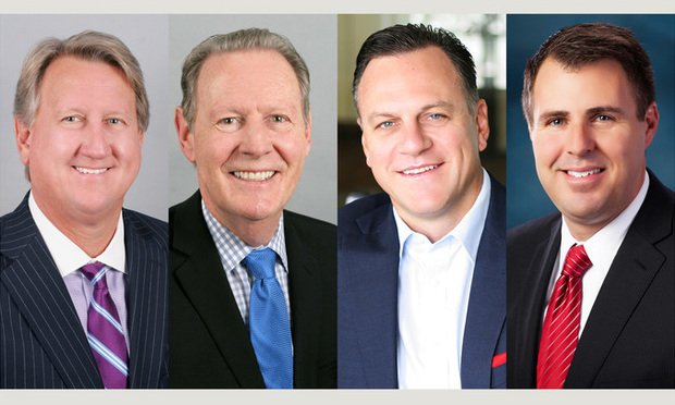 Avison Young principal and Miami managing director Michael Fay, and principals Jay Ziv, John Crotty and David Duckworth.