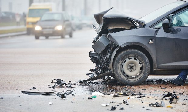 Car accident/photo by Dmitry Kalinovsky/Shutterstock.com