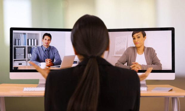 Businesswoman chats with her coworkers online. Photo: Rocketclips, Inc./Shutterstock.com