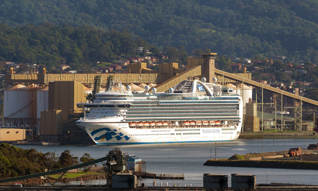 Port Kembla, NSW, Australia - April 9, 2020 Ruby Princess cruise ship with crew infected with COVID-19 docked at Port Kembla Grain terminal