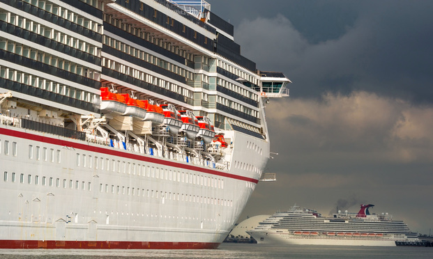 """The Carnival Corp. Miracle and Panorama cruise ships sit acnhored at the Port of Long Beach in Long Beach, California, U.S., on Monday, April 13, 2020. The Centers for Disease Control and Prevention extended its """"No Sail Order"""" for allcruiseships by at least 100 days -- or until Covid-19 is no longer considered a public health emergency. Photographer: Tim Rue/Bloomberg"""