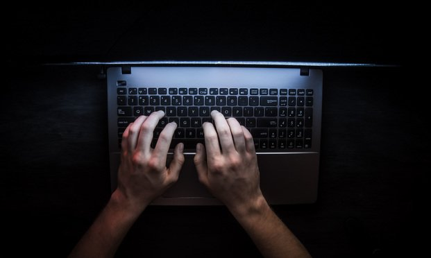 Hacker typing on keyboard. Photo: Lifestyle discover/Shutterstock.com.